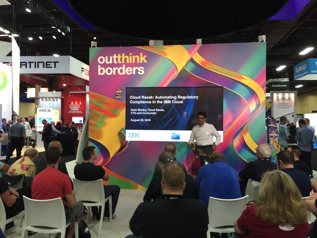 Cloud Raxak's CTO Sesh Murthy at VMworld giving a theater presentation on automating regulatory compliance in the IBM Cloud.